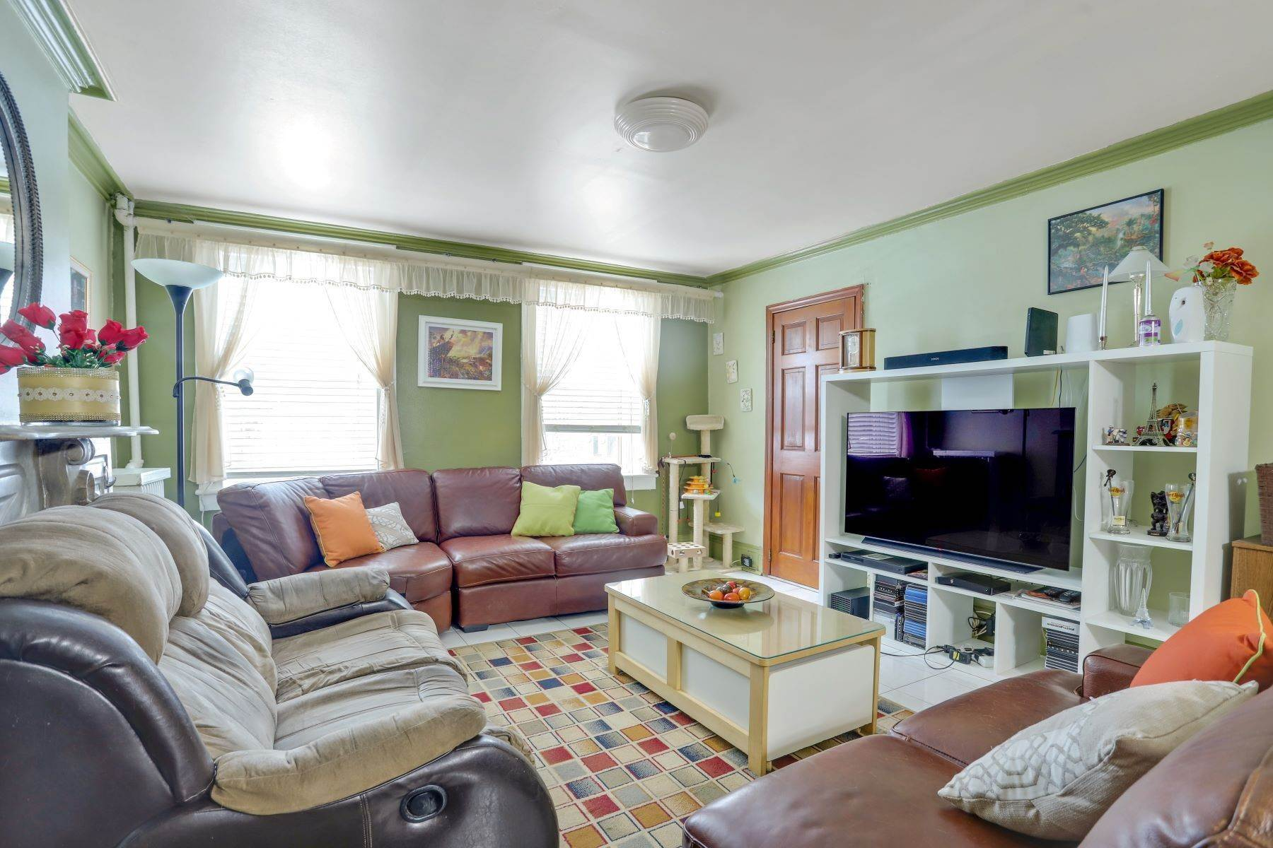 townhouses for Sale at Lovingly cared for 2 family home.. 152 Congress Street Jersey City, New Jersey 07307 United States