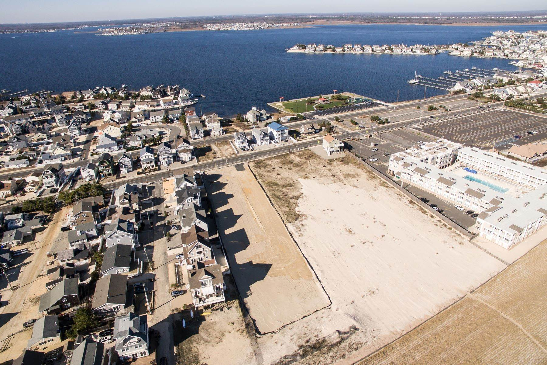 11. Single Family Homes for Sale at Unique Opportunity To Be Part Of A Brand New Private Beach Association 10 Cummins Street Mantoloking, New Jersey 08738 United States